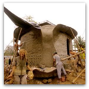 Scene from Garbage Warrior - building an Earthship in the Andaman Islands