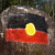 Aboriginal flag on a rock outside Yarrambah