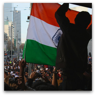 Protesting Indian student puts up flag, Flickr image by scissorhands33