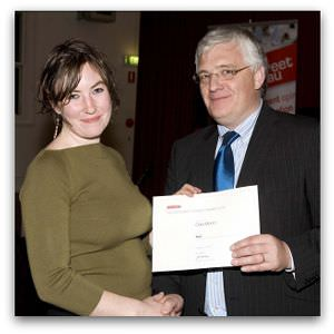 Cara Munro, third place in the 2008 Margaret Dooley Award, receives her award from Brendan Kilty