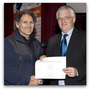 Arnold Zable, highly commended in the inaugural Eureka Street/Reader's Feast Award, receives his award from Brendan Kilty