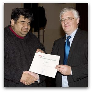 Irfan Yusuf, highly commended in the inaugural Eureka Street/Reader's Feast Award, receives his award from Brendan Kilty